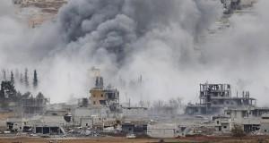 An explosion following an air strike is seen in central Kobani